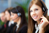 Busy call center operators — Stockfoto