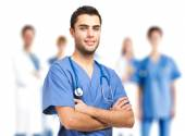 Handsome doctor in front of medical team — Foto Stock