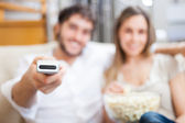 Couple using remote control — Stock Photo