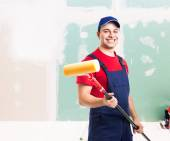 Friendly painter at work in an apartment — Stock Photo