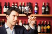 Man tasting glass of red wine — Stock Photo