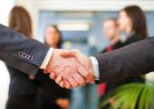 Business people shaking their hands — Stock Photo