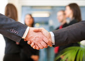 Business people shaking their hands — Foto de Stock