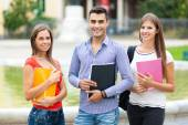 Smiling students outdoor — Stock Photo
