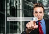 Man clicking a search button — Stock Photo