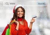 Woman showing her credit card — Stock Photo