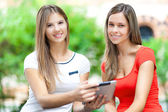 Girls with tablet — Stock Photo