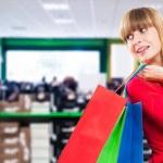 Woman shopping in shoe store — Stock Photo #57725529