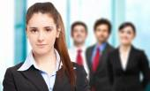 Woman in front of people — Stock Photo