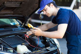 Mechanic working on car — Stock Photo