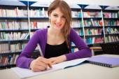 Smiling student in library — Stock Photo