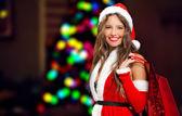 Woman doing shopping before christmas — Stock Photo