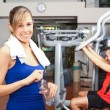 Woman working out in fitness club — Stock Photo #59864411