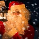 Santa Claus holding lantern — Stock Photo #59864435