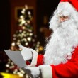 Santa Claus reading letter — Stock Photo #59864513