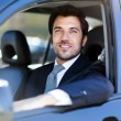 Smiling business man driving car — Stock Photo #59864531