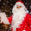 Santa Claus reading a letter — Stock Photo #59864571