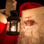 Santa Claus holding a lantern — Stock Photo #59864727