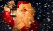 Santa Claus holding lantern — Stok fotoğraf