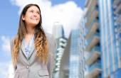 Smiling businesswoman in an urban setting — Stock Photo