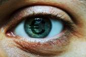 Man with an euro symbol in eye — Stockfoto