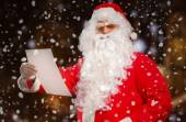 Santa Claus reading a letter — Stock Photo