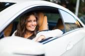 Woman driving her car — Stock Photo