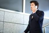 Mature businessman on phone — Stock Photo
