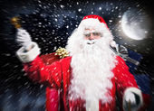 Santa Claus riding sled in night — Foto de Stock
