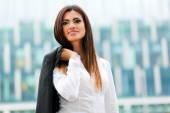 Businesswoman in an urban setting — Stock Photo