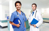 Two friendly doctors smiling — Foto Stock