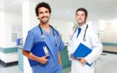 Two friendly doctors smiling — Stock Photo