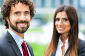 Two smiling business persons — Stockfoto
