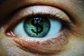 Man with dollar symbol in eye — Stockfoto