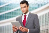 Businessman using his digital tablet — Stock Photo
