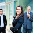 Businesswoman in front of a group of business people — Stock Photo #61558801