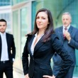 Businesswoman in front of a group of business people — Stock Photo #61558807