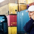 Worker in front of a stack of containers — Stock Photo #61559441