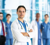 Doctor in front of his team — Stock Photo