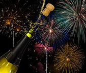 Bottle of champagne and fireworks — Stockfoto