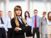 Woman in front of a group of business people — Stock Photo
