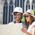 Tourists couple holding map — Stock Photo #62052189