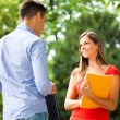 Students talking in park — Stock Photo #62052211