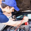 Mechanic using booster cables — Stock Photo #62052307