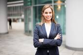 Business woman with crossed arms — Stock Photo