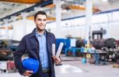 Industrial worker on factory — Stock Photo