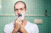 Man shave his beard off — Stock Photo