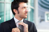Businessman adjusting his necktie — Stock Photo