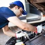 Mechanic repairing car — Stock Photo #63269013