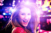 Smiling young girl in disco — Stock Photo